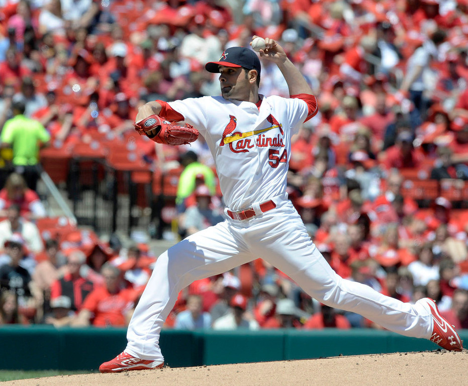 . St. Louis Cardinals\' starting pitcher Jaime Garcia throws against the Colorado Rockies in the first inning in a baseball game Sunday, May 12, 2013, at Busch Stadium in St. Louis. (AP Photo/Bill Boyce)