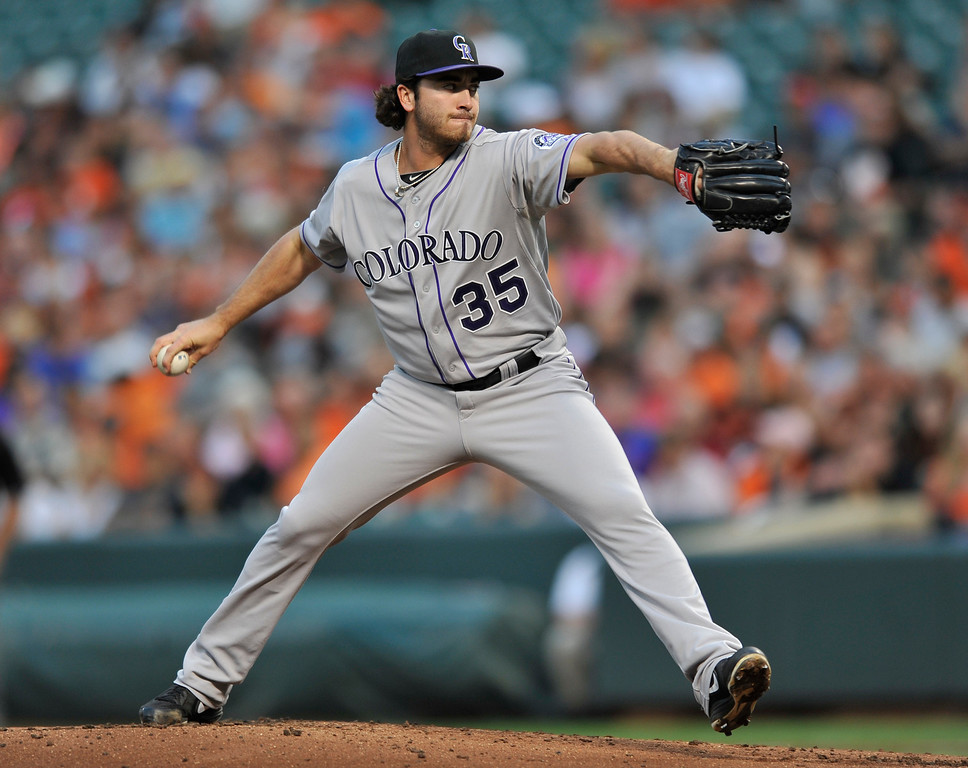 . Colorado Rockies pitcher Chad Bettis delivers against the Baltimore Orioles in the first inning of a baseball game on Saturday, Aug. 17, 2013 in Baltimore. (AP Photo/Gail Burton)