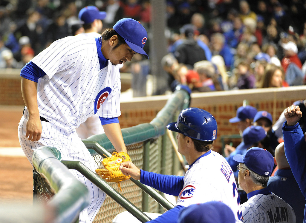 . Kyuji Fujikawa #11 of the Chicago Cubs is greeted after pitching the eighth inning against the Colorado Rockies on May 13, 2013 at Wrigley Field in Chicago, Illinois.   (Photo by David Banks/Getty Images)