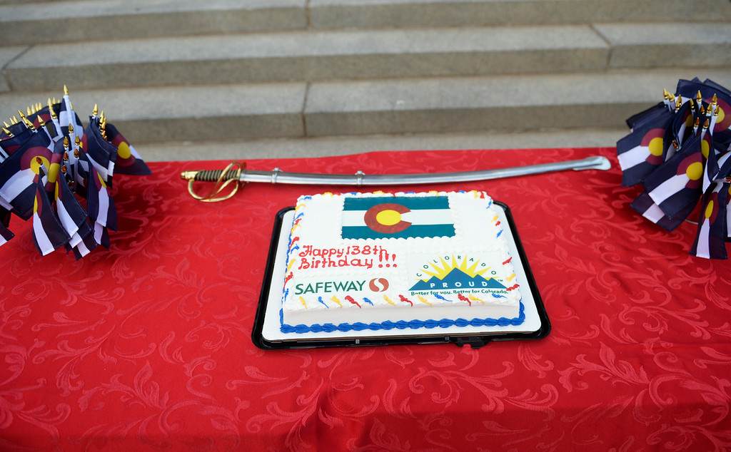. A cake celebrating 138th anniversary of the state of Colorado is on a table on the west steps of Colorado State Capitol in Denver, August 01, 2014. The celebration included dancing, a cake, a performance from the Colorado Army National Guard Band, and more. (Photo by RJ Sangosti/The Denver Post)