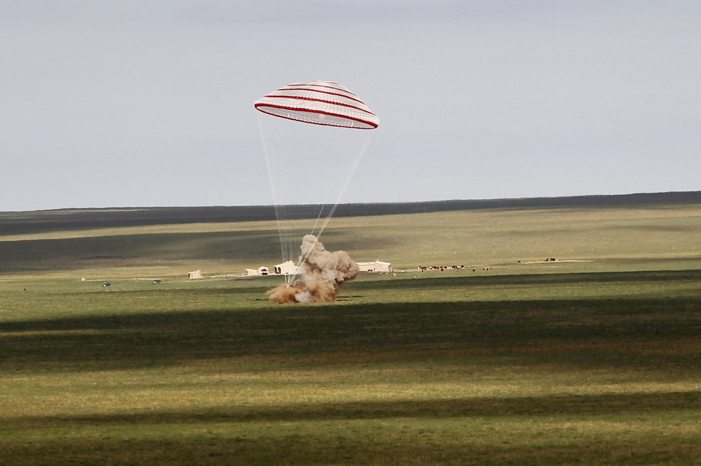 . The return capsule of the Shenzhou-10 spacecraft lands in the grasslands of north China\'s Inner Mongolia region on June 26, 2013, following a 15-day mission in space. China completed its longest manned space mission on June 26 as its Shenzhou-10 spacecraft and three crew members safely returned to Earth, in a major step towards Beijing\'s goal of building a permanent space station by 2020.  AFP PHOTOAFP/AFP/Getty Images