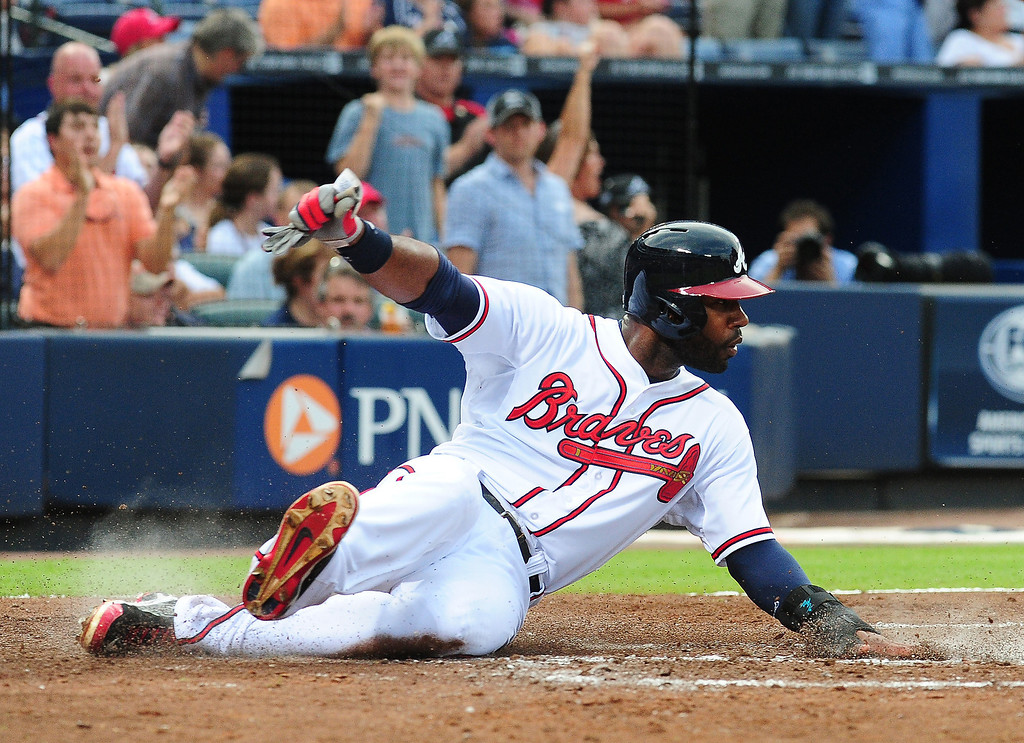 . Jason Heyward #22 of the Atlanta Braves slides in to home for a fourth inning run against the Colorado Rockies at Turner Field on July 30, 2013 in Atlanta, Georgia. (Photo by Scott Cunningham/Getty Images)