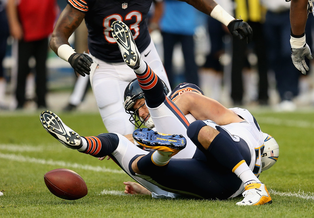 . CHICAGO, IL - AUGUST 15: Jay Cutler #6 of the Chicago Bears looses the ball after being sacked by Jarret Johnson #96 of the San Diego Chargers at Soldier Field on August 15, 2013 in Chicago, Illinois. (Photo by Jonathan Daniel/Getty Images)