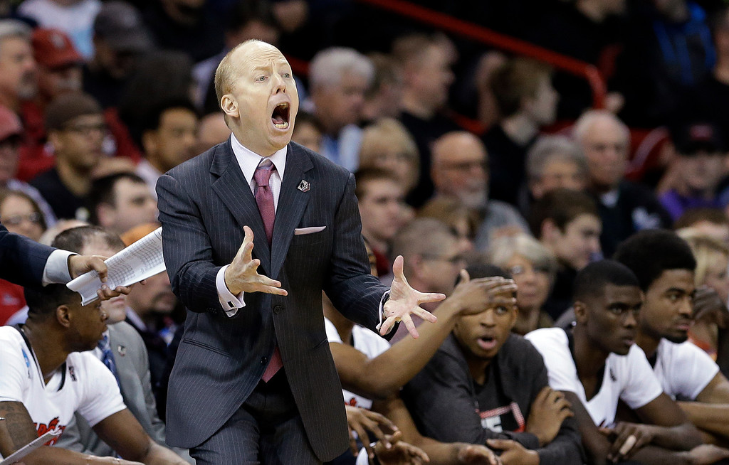 . Cincinnati head coach Mick Cronin reacts to a call in favor of Harvard during the second half in the second round of the NCAA college basketball tournament in Spokane, Wash., Thursday, March 20, 2014. Harvard won 61-57. (AP Photo/Elaine Thompson)