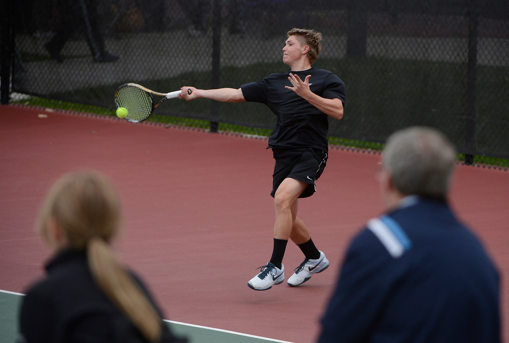 . DENVER, CO - OCTOBER 11:   Nicholas Farmen, Arapahoe High School, returns a shot against opponent, Ignatius Castelino, Fairview High School, (not pictured) during his #1 singles semi-final match at the 2013 State 5A Tennis Championships at the Gates Tennis Center in Denver, Colorado Friday morning, October 11, 2013. Farmen lost the match. (Photo By Andy Cross/The Denver Post)