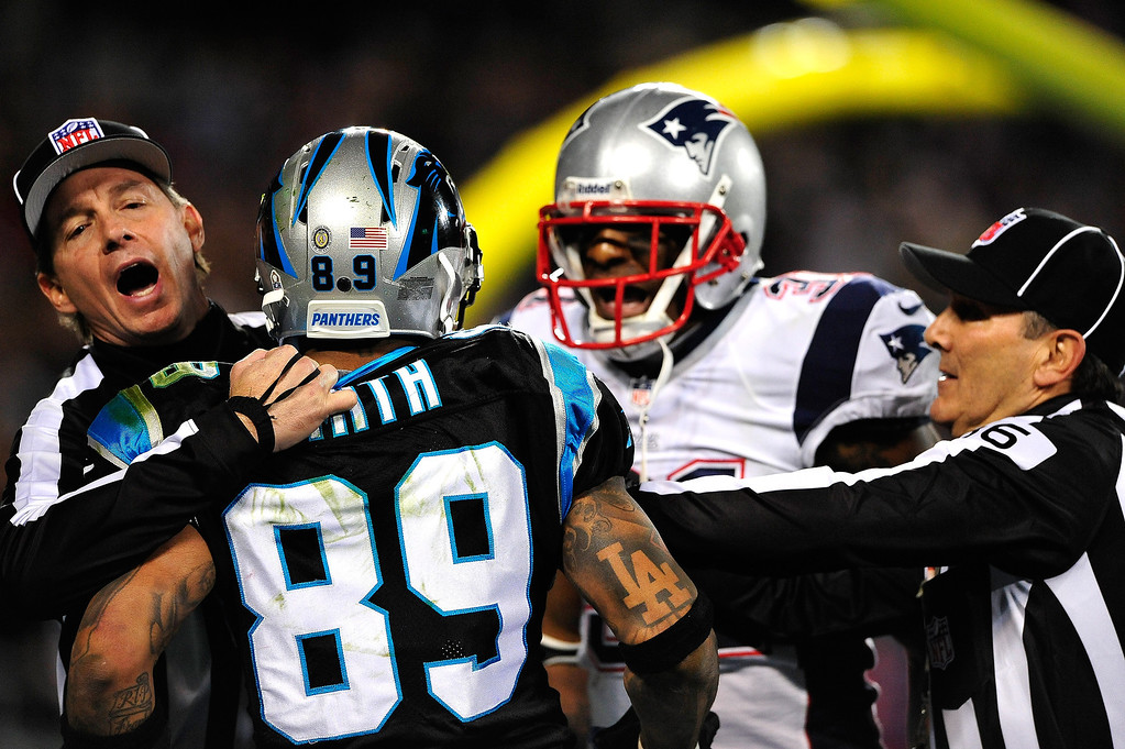 . Officials separate Aqib Talib #31 of the New England Patriots and Steve Smith #89 of the Carolina Panthers as the scuffle after a play at Bank of America Stadium on November 18, 2013 in Charlotte, North Carolina.  (Photo by Grant Halverson/Getty Images)