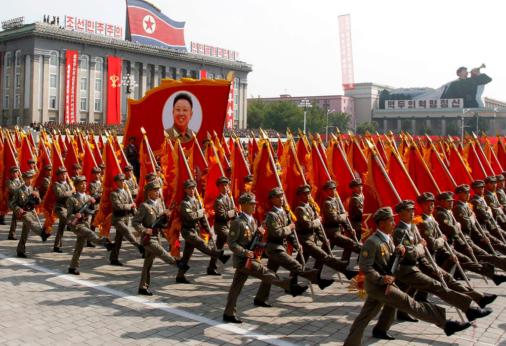. North Korean troops march past a portrait of the late leader Kim Jong Il during a military parade at Kim Il Sung Square to mark the 65th anniversary of the country\'s founding in Pyongyang, North Korea, Monday, Sept. 9, 2013. (AP Photo/Kim Kwang Hyon)