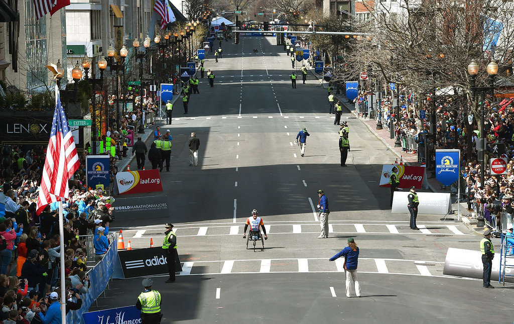 . Men\'s Wheelchair winner Ernst Van Dyk of South Africa, comes down Boylston Street on his way to winning the Men\'s Push Rim Wheelchair division of the 118th Boston Marathon in Boston, Massachusetts April 21, 2014 .  AFP PHOTO / Timothy A.  CLARY/AFP/Getty Images