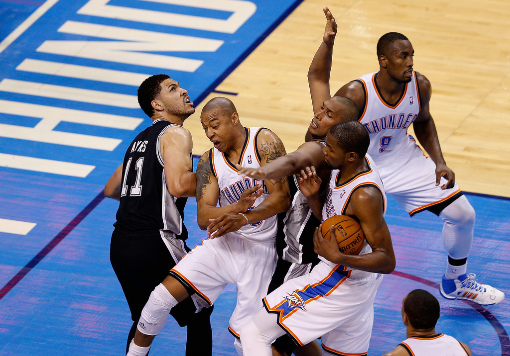 . OKLAHOMA CITY, OK - MAY 27: Kevin Durant #35 and Caron Butler #2 of the Oklahoma City Thunder tangle with Jeff Ayres #11 and Boris Diaw #33 of the San Antonio Spurs in the second half during Game Four of the Western Conference Finals of the 2014 NBA Playoffs at Chesapeake Energy Arena on May 27, 2014 in Oklahoma City, Oklahoma. (Photo by Joe Robbins/Getty Images)