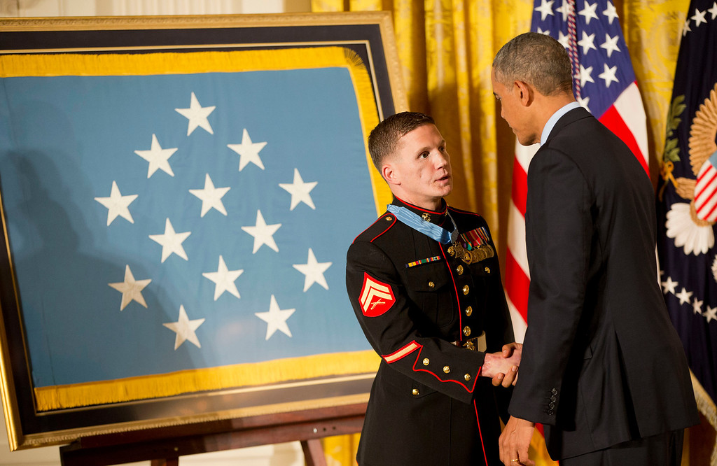 """. President Barack Obama shakes hands with retired Marine Cpl. William \""""Kyle\"""" Carpenter after awarding him the Medal of Honor, Thursday, June 19, 2014, in the East Room of the White House in Washington. (AP Photo/Pablo Martinez Monsivais)"""