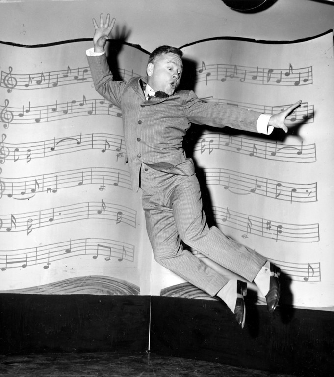 """. n this March 19, 1957, file photo, actor, singer and dancer Mickey Rooney, wearing spats and a pinstriped suit, performs a dance routine during rehearsal for the television show \""""George M. Cohan Story\"""" in Hollywood, Calif.  (AP Photo/File)"""