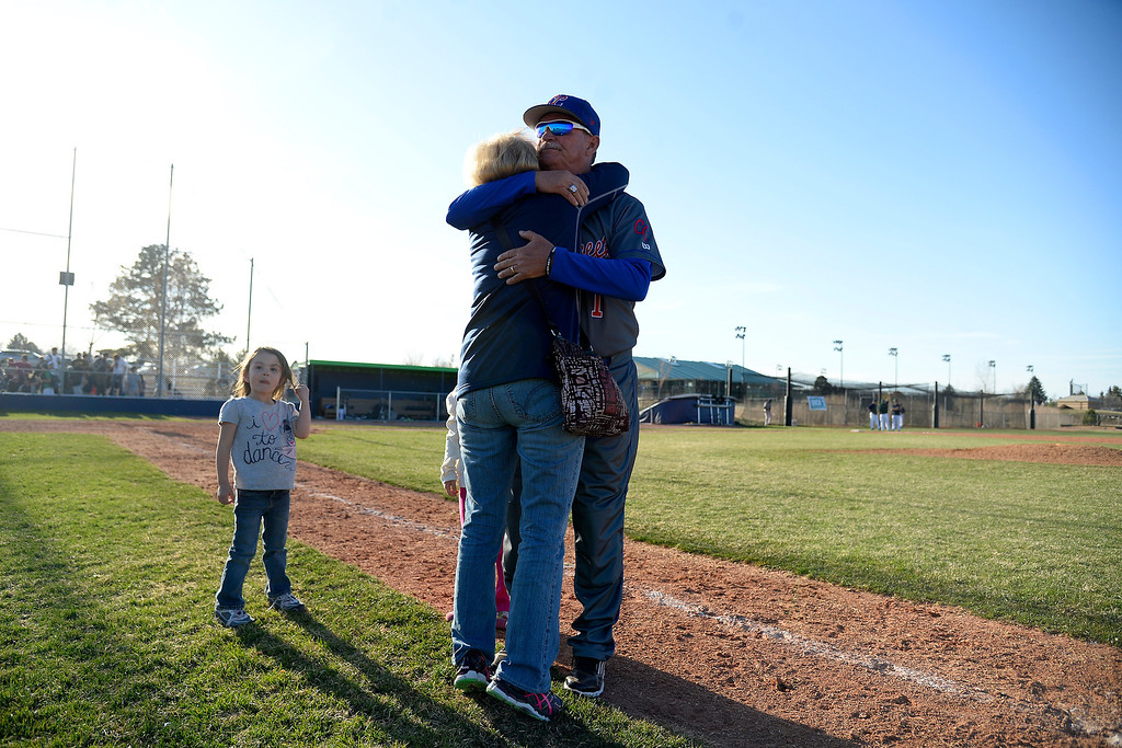. Aurora, CO - APRIL 08: Head coach Marc Johnson of the Cherry Creek Bruins hugs his wife Peggy after winning his 700th career game as the Bruins visited Overland Trailblazers. Overland hosted Cherry Creek on Tuesday, April 8, 2014. (Photo by AAron Ontiveroz/The Denver Post)