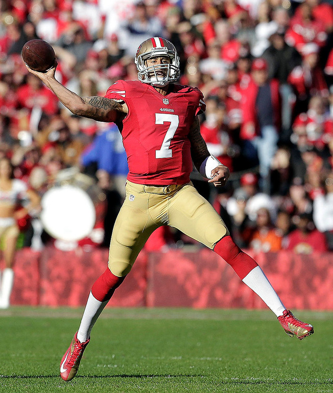 . San Francisco 49ers quarterback Colin Kaepernick passes against the Arizona Cardinals during the second quarter of an NFL football game in San Francisco, Sunday, Dec. 30, 2012. (AP Photo/Tony Avelar)