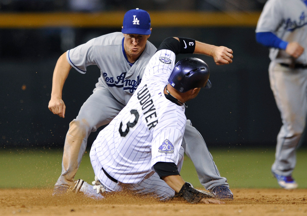 . Los Angeles Dodgers second baseman Mark Ellis tags out Colorado Rockies\' Michael Cuddyer (3) at second on an attempted steal during the sixth inning of a baseball game, Tuesday, Sept. 3, 2013, in Denver. (AP Photo/Jack Dempsey)