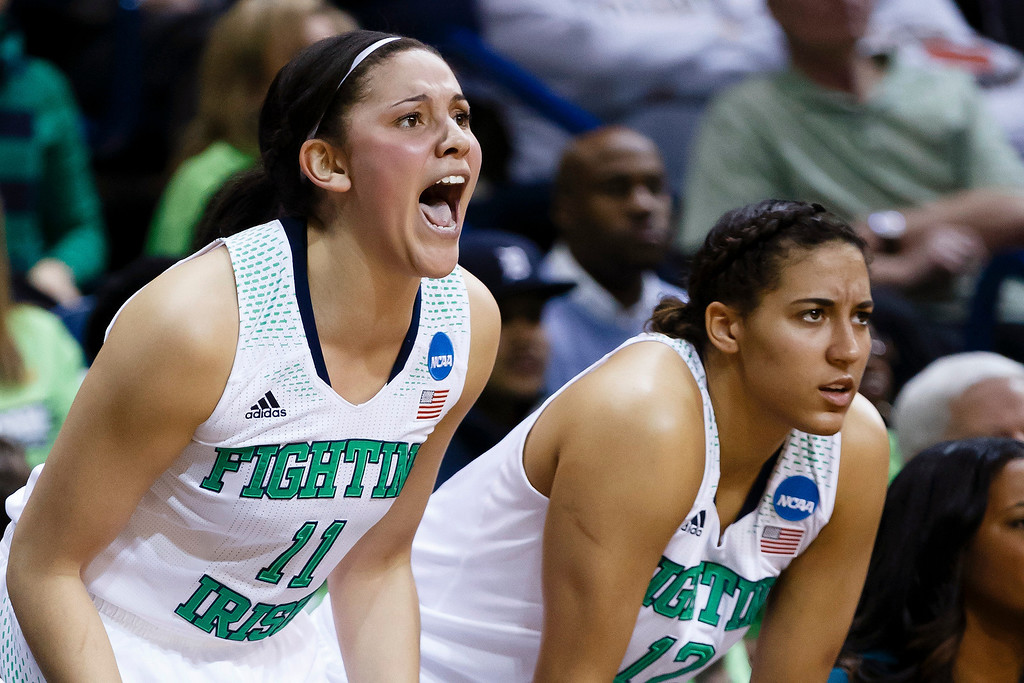. Notre Dame forward Natalie Achonwa, left, and forward Taya Reimer, right, cheer their team on during the second half against Arizona State in an second-round game in the NCAA women\'s college basketball tournament in Toledo, Ohio, Monday, March 24, 2014. Notre Dame defeated Arizona State 84-67. (AP Photo/Rick Osentoski)