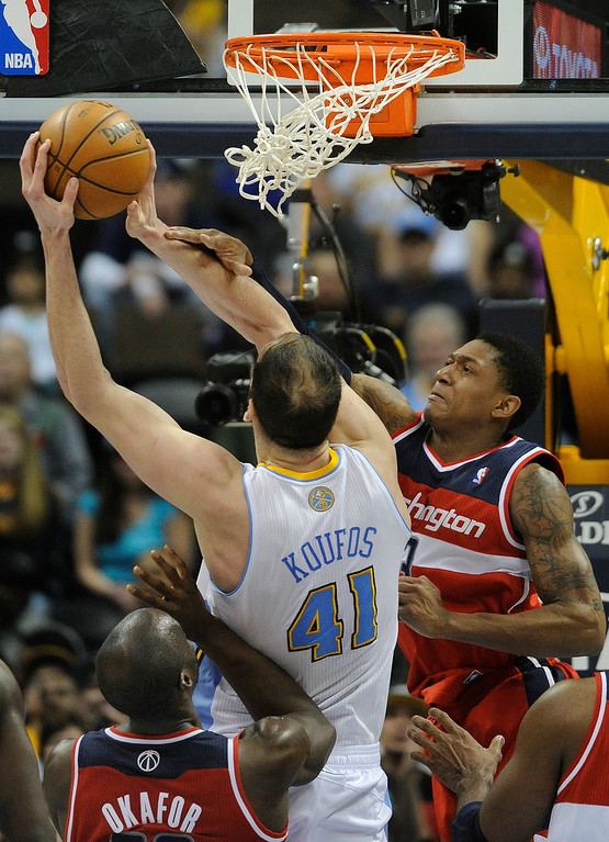 . DENVER, CO - JANUARY 18: Washington guard Bradley Beal (3) fouled Denver center Kosta Koufos (41) as he went to the hoop in the second half. The Washington Wizards defeated the Denver Nuggets 112-108 at the Pepsi Center Friday night, January 18, 2013. Karl Gehring/The Denver Post