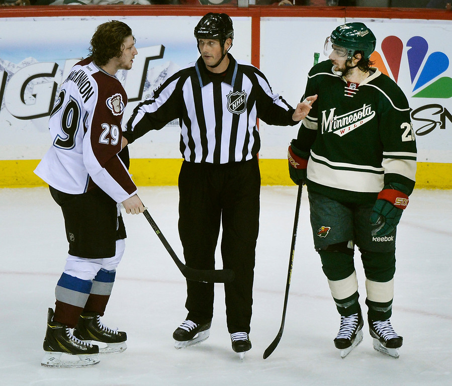 . Colorado center Nathan MacKinnon (29) had words with Minnesota wing Matt Moulson (26) in the second period.   (Photo by Karl Gehring/The Denver Post)