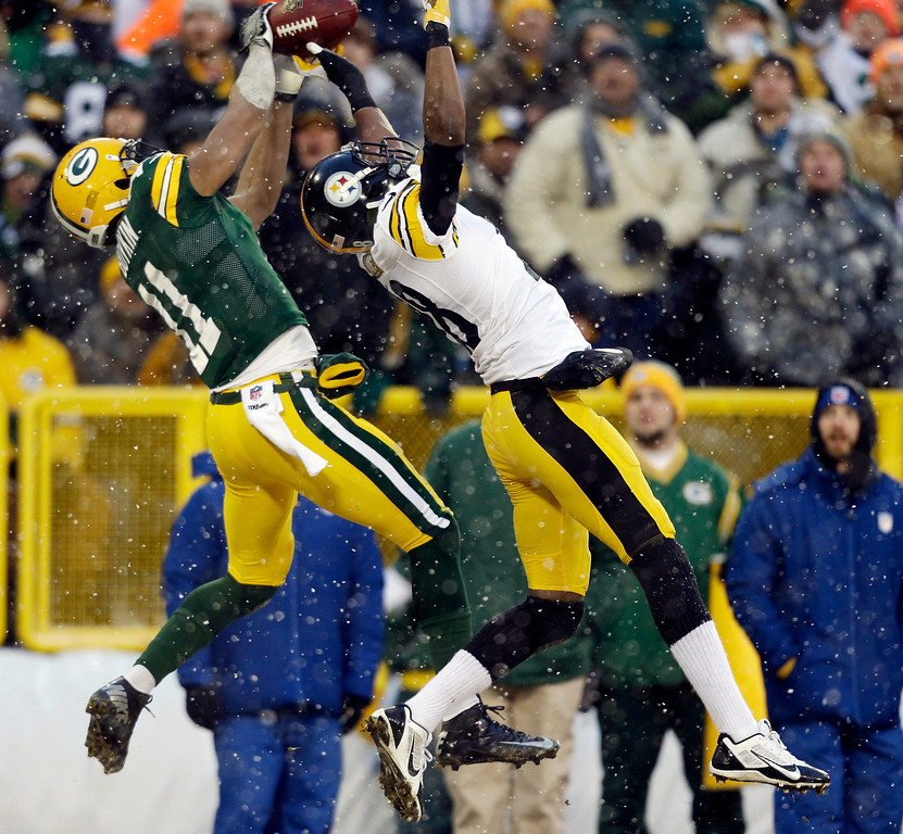 . Pittsburgh Steelers\' Cortez Allen breaks up a pass intended for Green Bay Packers\' Jarrett Boykin (11) during the first half of an NFL football game Sunday, Dec. 22, 2013, in Green Bay, Wis. (AP Photo/Jeffrey Phelps)
