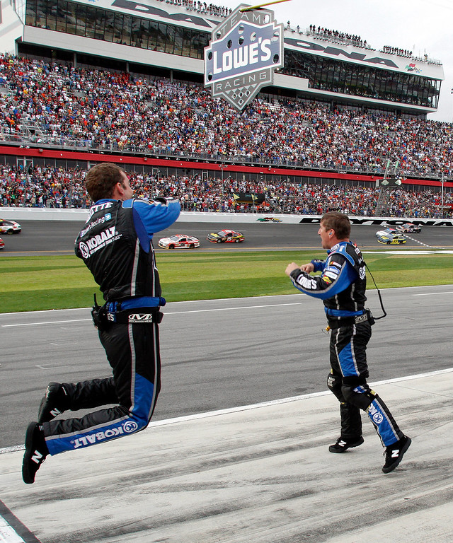 . Members of Jimmie Johnson\'s crew celebrate on pit road after he crossed the finish line to win the NASCAR Daytona 500 Sprint Cup Series auto race at Daytona International Speedway, Sunday, Feb. 24, 2013, in Daytona Beach, Fla. (AP Photo/Reinhold Matay)
