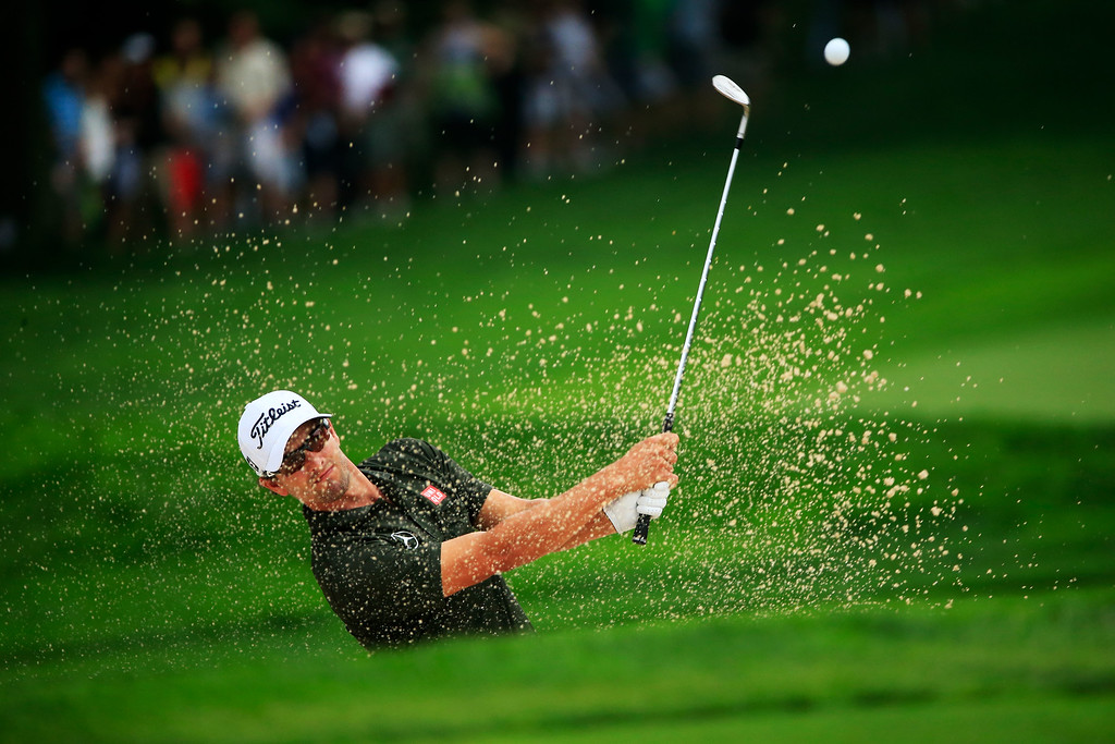 . ROCHESTER, NY - AUGUST 09:  Adam Scott of Australia plays a shot from a bunker on the fourth hole during the second round of the 95th PGA Championship on August 9, 2013 in Rochester, New York.  (Photo by Sam Greenwood/Getty Images)