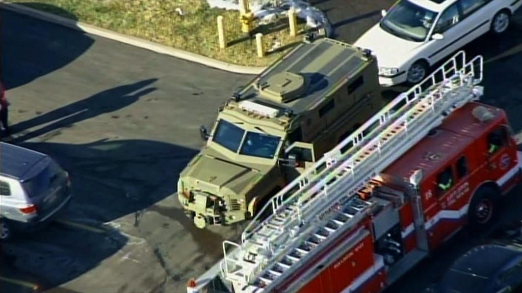 """. In this framegrab taken from video by KCNC television news in Denver, an armored vehicle (L) and fire engine arrive at Arapahoe High School in Centennial, Colorado, on December 13, 2013 after a shooting at the school. Two students were injured in the shooting incident before the suspected gunman apparently killed himself, the local sheriff said. The suspect was also a student. \""""That individual is .. deceased, he apparently killed himself,\"""" Arapahoe County Sheriff Grayson Robinson told reporters.     AFP PHOTO / KCNC /AFP/Getty Images"""