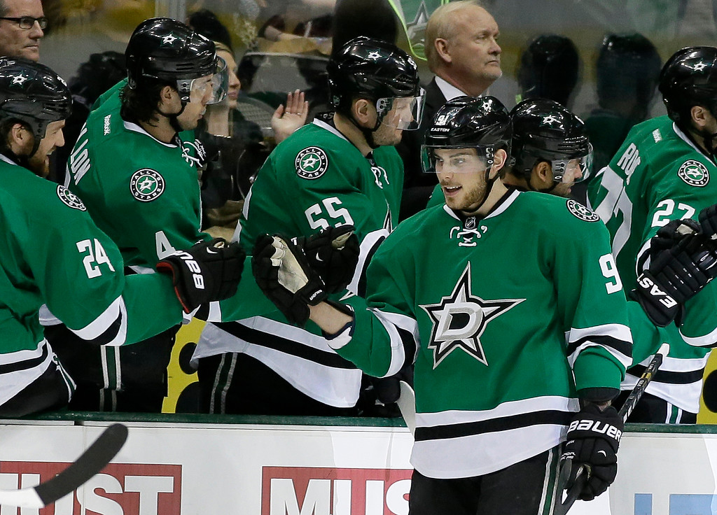 . Dallas Stars center Tyler Seguin (91) is congratulated by Jordie Benn (24) and the rest of the bench following his first goal of the second period during an NHL hockey game against the Colorado Avalanche, Monday, Jan. 27, 2014, in Dallas. Seguin scored twice in the period. (AP Photo/Tony Gutierrez)