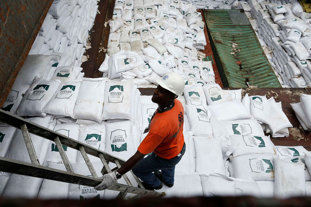 ". A worker stands nest to gags labeled ""Cuban Raw Sugar\"" are seen inside a North Korean flagged ship \""Chong Chon Gang\"" docked at the Manzanillo Container Terminal in Colon City July 16, 2013.  REUTERS/Carlos Jasso"