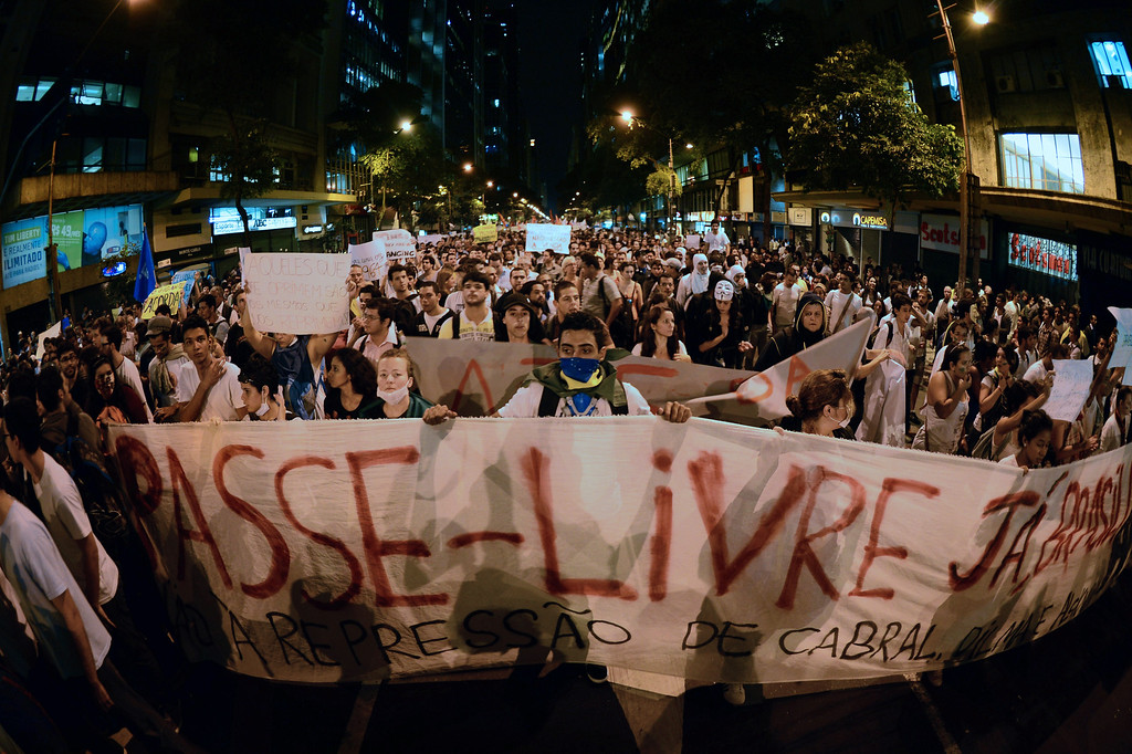 . Demonstrators march in Rio de Janeiro downtown on June 17, 2013, against higher public transportation fares and the use of public funds to disrupt international football tournaments. CHRISTOPHE SIMON/AFP/Getty Images