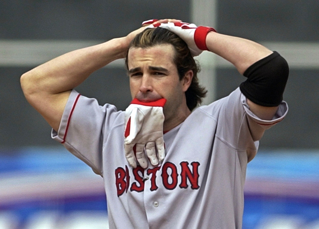 . TODD WALKER -- Boston Red Sox\' Todd Walker puts his hands on his head at the end of the fifth inning against the Oakland Athletics in game 2 of the American League Divisional Series playoff game on Oct. 2, 2003, in Oakland, Calif.  (AP Photo/Ben Margot)