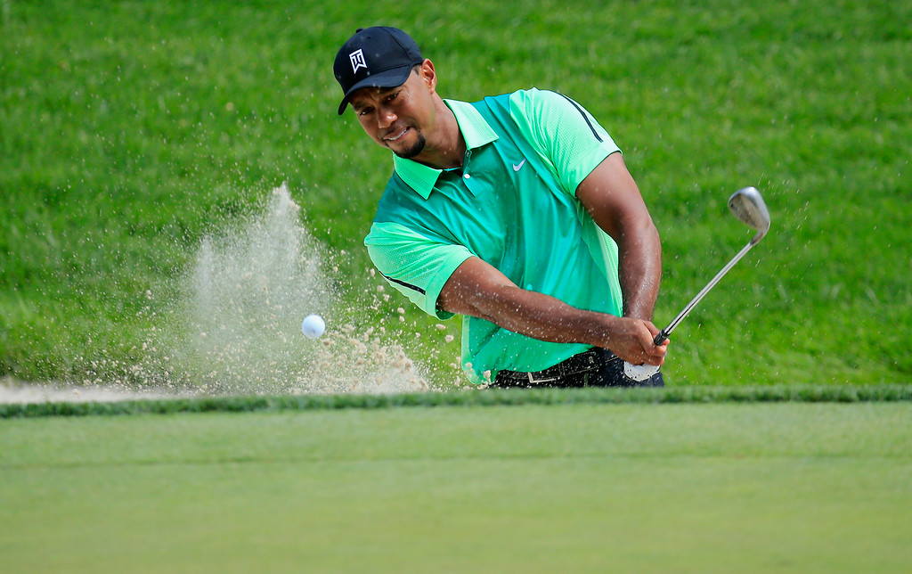 . BETHESDA, MD - JUNE 26:  Tiger Woods of the United States hits out of the bunker on the third hole during the first round of the Quicken Loans National at Congressional Country Club on June 26, 2014 in Bethesda, Maryland.  (Photo by Rob Carr/Getty Images)