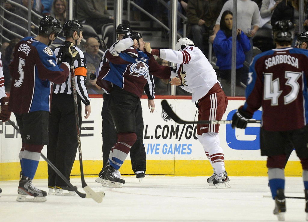. DENVER, CO. - FEBRUARY 11: Cody McCloud (55) of the Colorado Avalanche fights with Kyle Chipchura (24) of the Phoenix Coyotes during the first period February 11, 2013 at Pepsi Center.(Photo By John Leyba/The Denver Post)