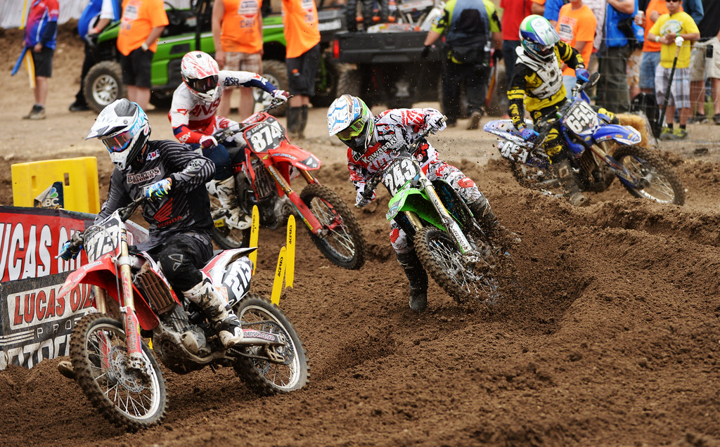 . Racers are competing during 250 class Moto #1 of the third round of the Lucas Oil Pro Motocross Championship at Thunder Valley MX Park. Lakewood, Colorado. June 07. 2014. (Photo by Hyoung Chang/The Denver Post)
