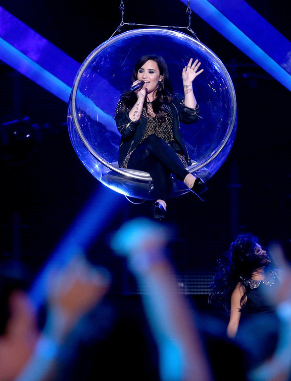 ". LOS ANGELES, CA - DECEMBER 16:  Singer Demi Lovato performs onstage during ""VH1 Divas\"" 2012 at The Shrine Auditorium on December 16, 2012 in Los Angeles, California.  (Photo by Christopher Polk/Getty Images)"