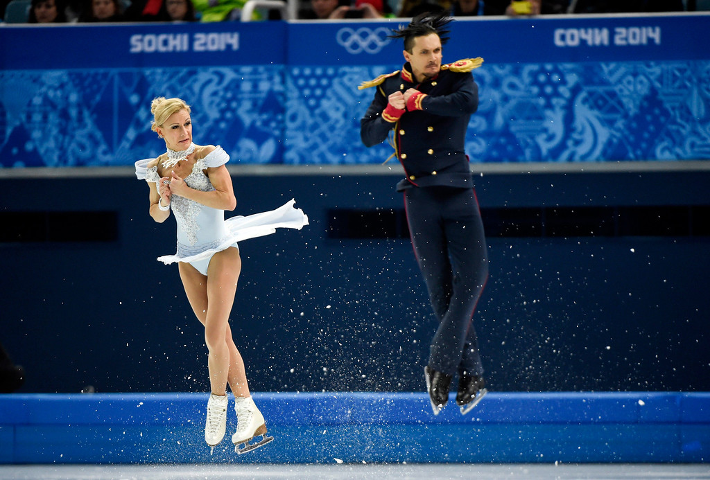 Description of . Tatiana Volosozhar and Maxim Trankov of Russia compete in the pairs short program figure skating competition at the Iceberg Skating Palace during the 2014 Winter Olympics, Tuesday, Feb. 11, 2014, in Sochi, Russia. (AP Photo/The Canadian Press, Paul Chiasson)