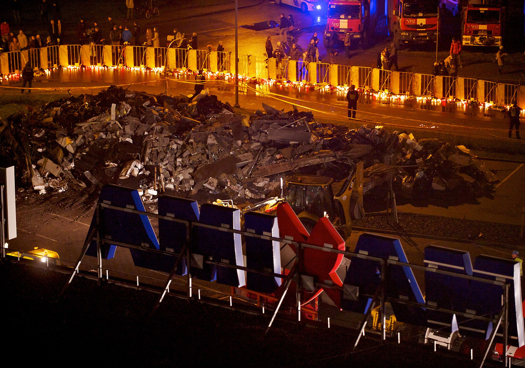 . People lighted candles at the scene where the Maxima supermarket roof collapsed on November 23, 2013 in Riga, caving in on shoppers.   AFP PHOTO / ILMARS  ZNOTINS/AFP/Getty Images