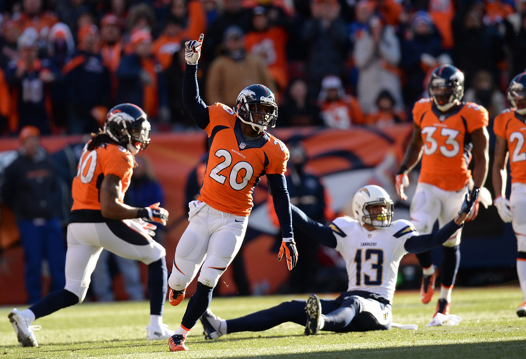 . Denver Broncos free safety Mike Adams (20) breaks up a pass to San Diego Chargers wide receiver Keenan Allen (13) in the first quarter. The Denver Broncos take on the San Diego Chargers at Sports Authority Field at Mile High in Denver on January 12, 2014. (Photo by Hyoung Chang/The Denver Post)