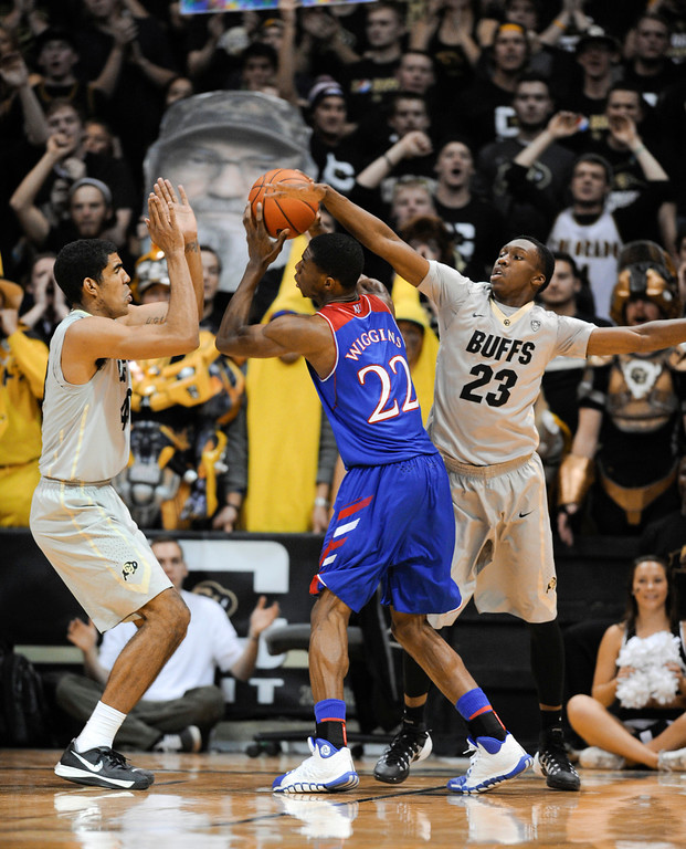 . Colorado University defenders, Josh Scott, left, and Jaron Hopkins; right, give Kansas guard, Andrew Wiggins, center, a difficult time in the second half of play at the Coors Events Center in Boulder Colorado Saturday afternoon, December 07, 2013. (Photo By Andy Cross/The Denver Post)