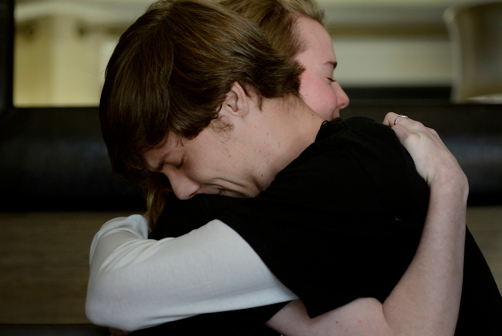 . Arapahoe High School students Avery Griggs, 16, and Joe Redmond, 18, embrace while talking about the shooting at Arapahoe High School in Centennial, CO December 14, 2013. Both students were on the debate team with the gunman as Karl Pierson and Griggs is friends with shooting victim Claire Davis. (Photo By Craig F. Walker / The Denver Post)
