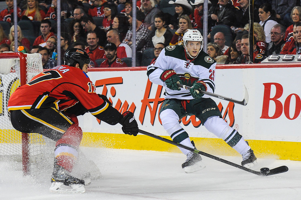 . Lance Bouma #17 of the Calgary Flames tries to block the pass of Jonas Brodin #25 of the Minnesota Wild during an NHL game at Scotiabank Saddledome on February 1, 2014 in Calgary, Alberta, Canada. (Photo by Derek Leung/Getty Images)