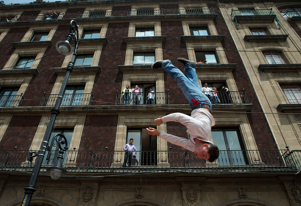 . A circus performer does flips on a trampoline during a protest against a city law banning the use of animals in circuses in Mexico City\'s Zocalo, Tuesday, June 10, 2014. Acrobats, clowns and other circus employees are protesting Mexico City\'s new ban. (AP Photo/Rebecca Blackwell)