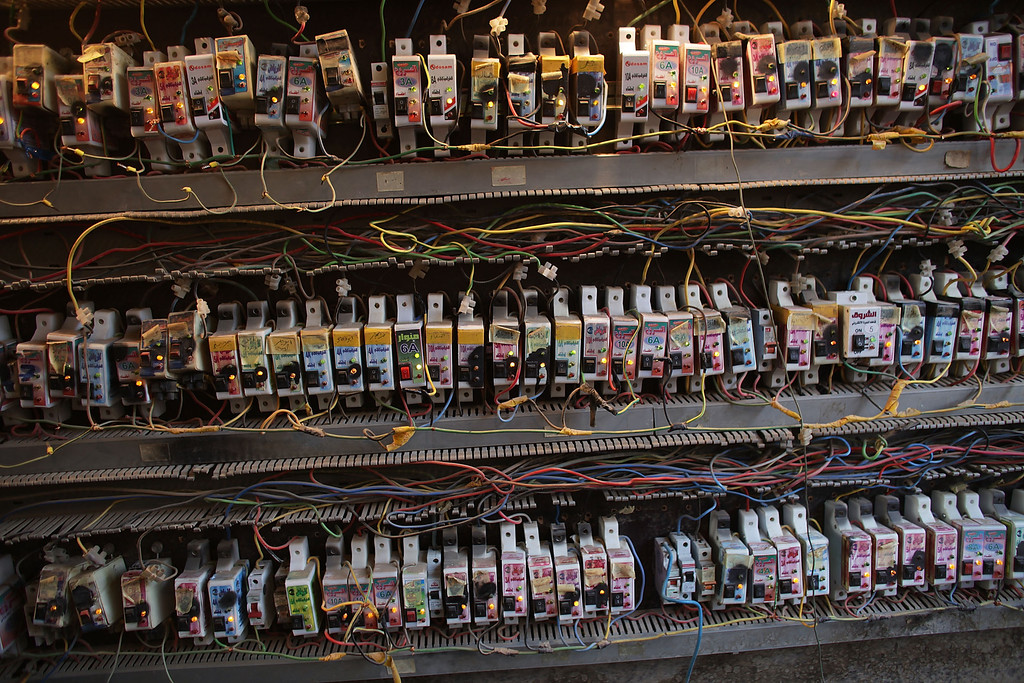 . Over 100 electric boxes connect homes in a building to a collective generator in a poor neighborhood on July 25, 2011 in Baghdad, Iraq. Despite a doubling of the megawatts of electricity available to Iraqis, many people still only receive a few hours of electricity a day from the national grid and therefore have to depend on generators and other private sources of electricity. With more homes owning computers, televisions, refrigerators and air conditioners there is an increased demand for electricity, especially in the scorching summers. The lack of dependable electricity has been one of the main sources of demonstrations against the government. As the deadline for the departure of the remaining American forces in Iraq approached, Iraqi politicians were increasingly pressured to give a final decision about extending the mandate for a small U.S. military presence beyond the end of the 2011 deadline.  (Photo by Spencer Platt/Getty Images)