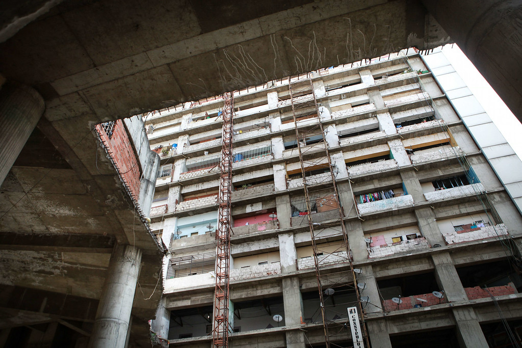 . Picture taken at the Tower of David, an abandoned skyscraper in Caracas originally intended to be an office building that became a \'vertical slum\', during its eviction on July 22, 2014. The government began the eviction and relocation of hundreds of families that were illegally occupying the building. FEDERICO PARRA/AFP/Getty Images