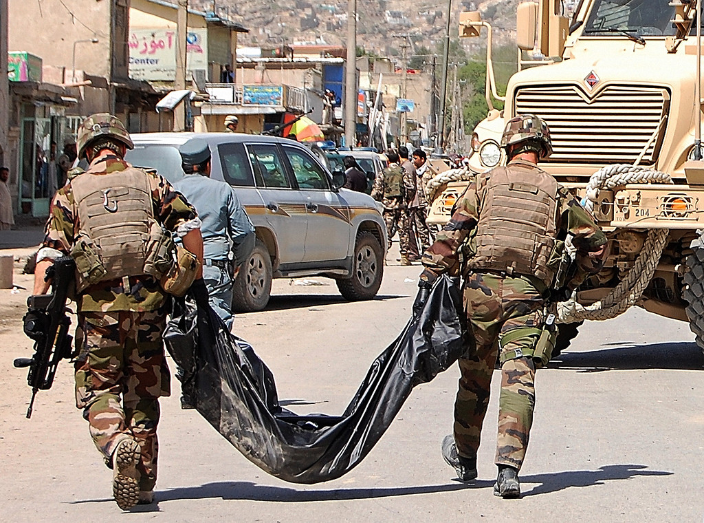 . French soldiers with the NATO-led International Security Assistance Force (ISAF) carry away the body of a victim from the site of a suicide attack in Kabul on May 16, 2013. AFP PHOTO/Daud YardostDAUD YARDOST/AFP/Getty Images