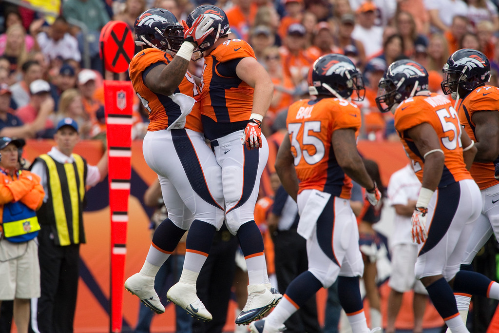 . DENVER, CO - AUGUST 24: Mitch Unrein (96) of the Denver Broncos celebrates his sack with Terrance Knighton (94) during the first half of action of an NFL preseason game at Sports Authority Field at Mile High on August 24, 2013. This is the third game of the preseason for the Broncos. (Photo by AAron Ontiveroz/The Denver Post)