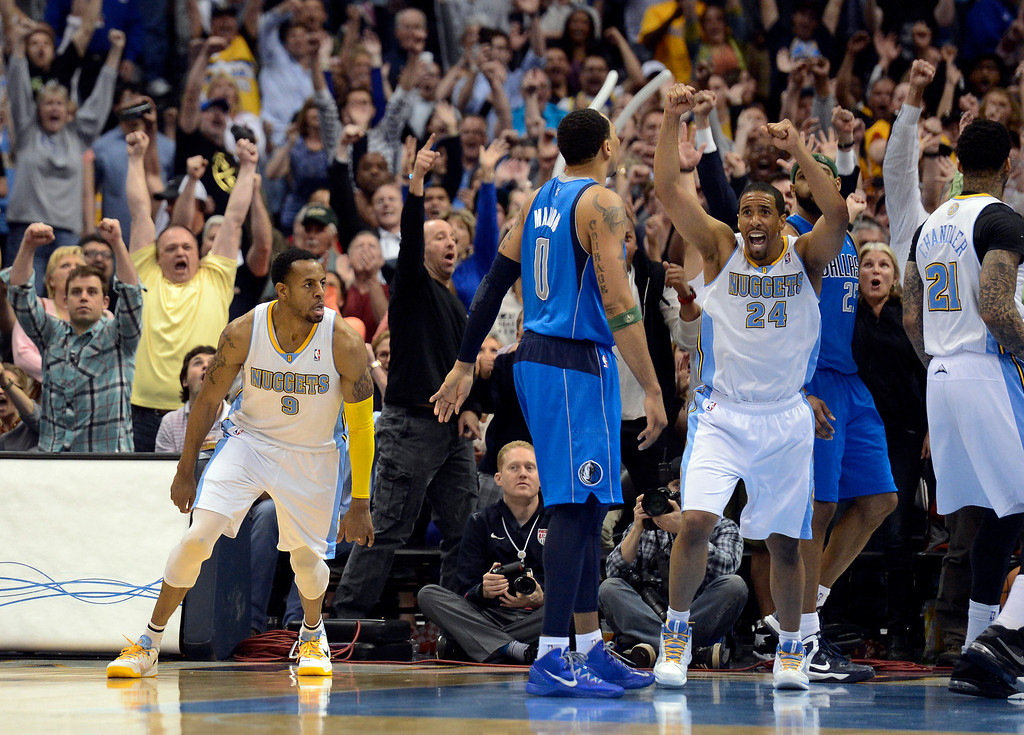 . DENVER, CO. - APRIL 04: Andre Miller (24) of the Denver Nuggets celebrates Andre Iguodala (9) of the Denver Nuggets game winning shot over Vince Carter (25) of the Dallas Mavericks with 2.8 seconds in the game April 4,  2013 at Pepsi Center. The Denver Nuggets defeated the Dallas Mavericks 95-94. (Photo By John Leyba/The Denver Post)