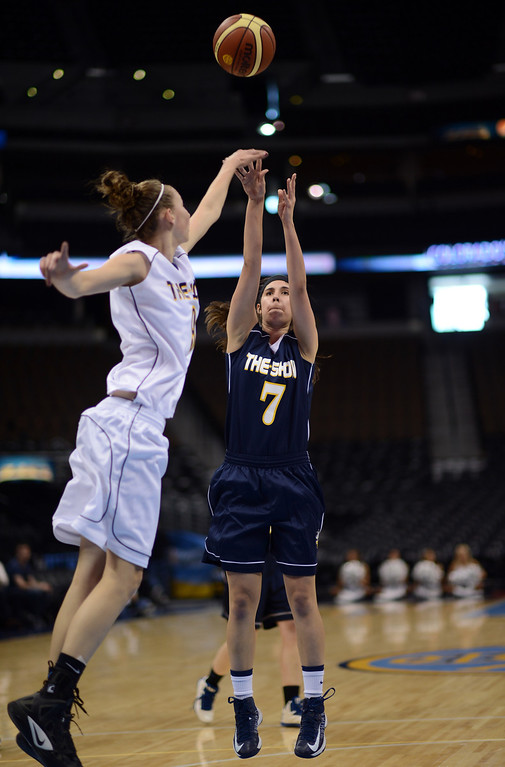 . DENVER, CO. - APRIL 06 : Blue team Taylor Leyva of Pueblo West High School (7), right, aims a basket over White team Kylee Shook of Mesa Ridge High School (9) during The Show, Colorado\'s High School All-Star game, at Pepsi Center. Denver, Colorado. April 6, 2013. Blue team won 59-51. (Photo By Hyoung Chang/The Denver Post)