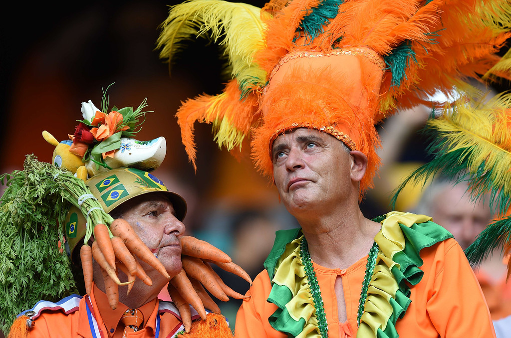 . Fans of the Netherlands look on before a Group B football match between Spain and the Netherlands at the Fonte Nova Arena in Salvador during the 2014 FIFA World Cup on June 13, 2014. JAVIER SORIANO/AFP/Getty Images