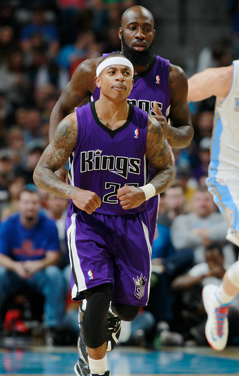 . Sacramento Kings guard Isaiah Thomas, front, reacts after hitting a 3-point shot as forward Quincy Acy trails down the court in the third quarter of an NBA basketball game against the Denver Nuggets, in Denver on Sunday, Feb. 23, 2014. The Kings won 109-95. (AP Photo/David Zalubowski)