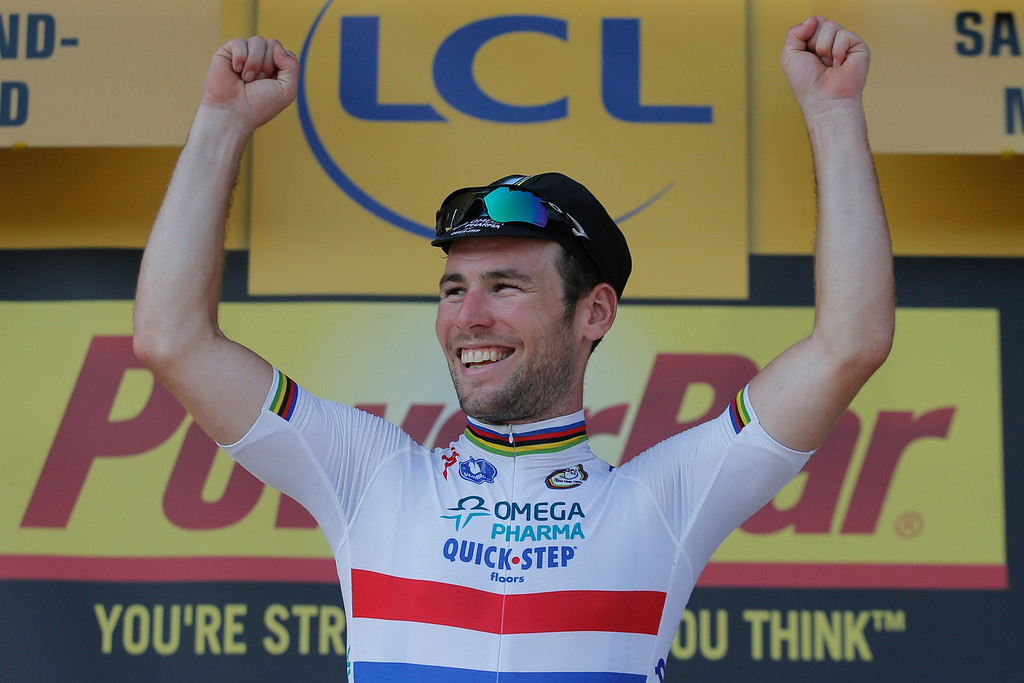 . Stage winner Mark Cavendish of Britain celebrates on the podium of the thirteenth stage of the Tour de France cycling race over 173 kilometers (108.1 miles) with start in in Tours and finish in Saint-Amand-Montrond, western France, Friday July 12 2013. (AP Photo/Christophe Ena)