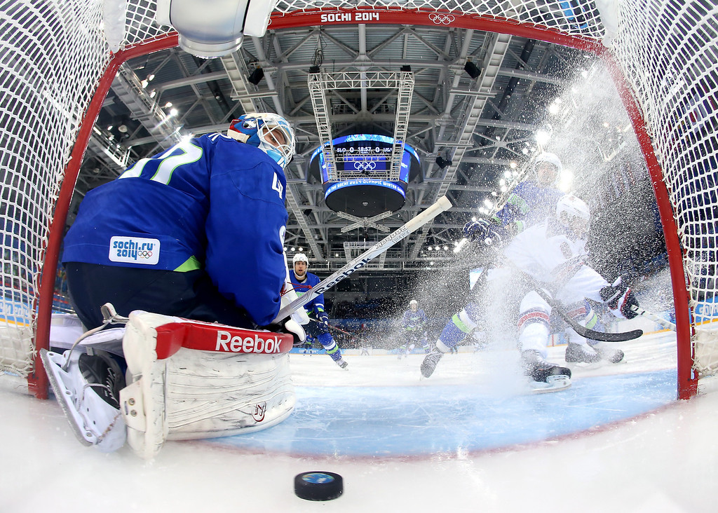 . Luka Gracnar #40 of Slovenia gives up a goal to Phil Kessel #81 of the United States as Joe Pavelski #8 slides to a stop in front of the net in the first period during the Men\'s Ice Hockey Preliminary Round Group A game on day nine of the Sochi 2014 Winter Olympics at Shayba Arena on February 16, 2014 in Sochi, Russia.  (Photo by Martin Rose/Getty Images)